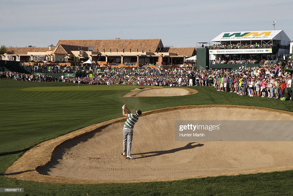 Keegan Bradley hits his second shot on the 18th hole during the third round of the Waste Management Phoenix Open at TPC Scottsdale on February 2, 2013 in Scottsdale, Arizona.
