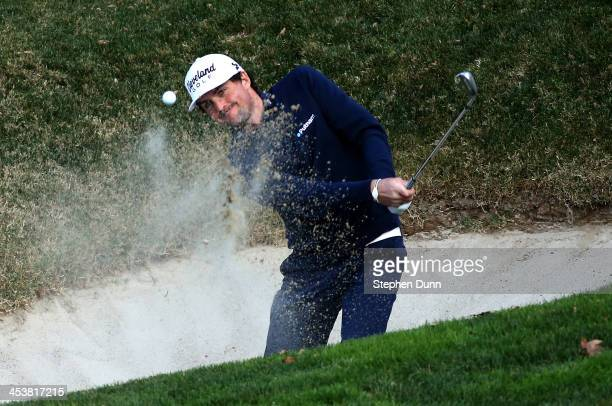 Keegan Bradley hits out of a bunker on the fifth hole during the first round of the Northwestern Mutual World Challenge at Sherwood Country Club on...