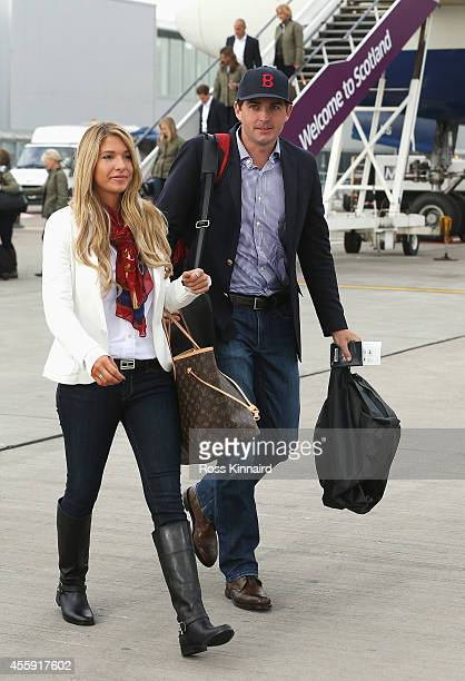 Keegan Bradley of the United States and partner Jillian Stacey arrive at Edinburgh Airport ahead of the 2014 Ryder Cup at Gleneagles on September 22...