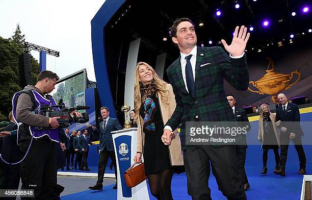 Keegan Bradley of the United States and partner Jillian Stacey leave the arena after the Opening Ceremony ahead of the 40th Ryder Cup at Gleneagles...