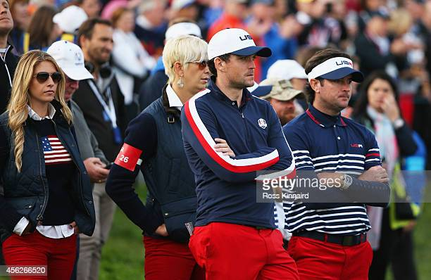 Keegan Bradley of the United States and partner Jillian Stacey look dejected with Bubba Watson of the United States and wife Angie after Europe won...