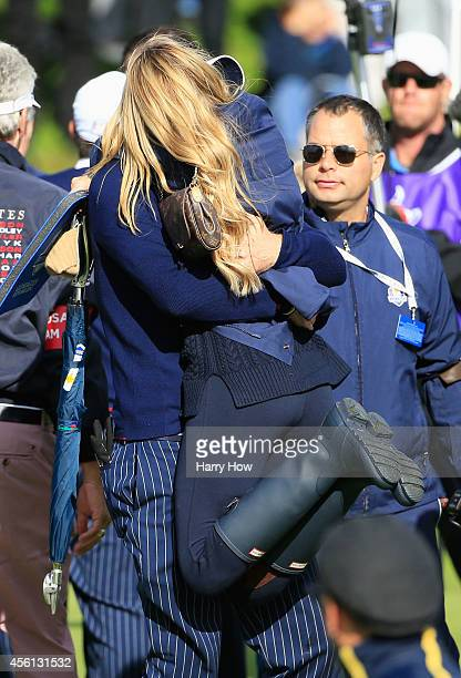 Keegan Bradley of the United States celebrates victory with Jillian Stacey after the Morning Fourballs of the 2014 Ryder Cup on the PGA Centenary...