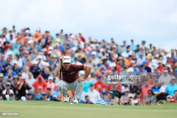 Keegan Bradley of the United States lines up a putt on the ninth hole during the final round of the 2017 U.S. Open at Erin Hills on June 18, 2017 in...