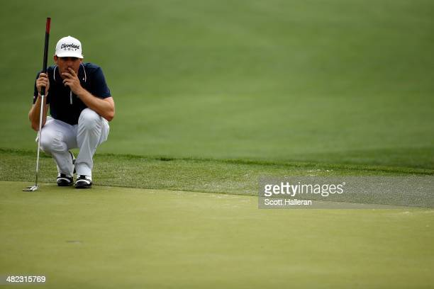 Keegan Bradley of the United States lines up an eagle putt on the eighth green during round one of the Shell Houston Open at the Golf Club of Houston...