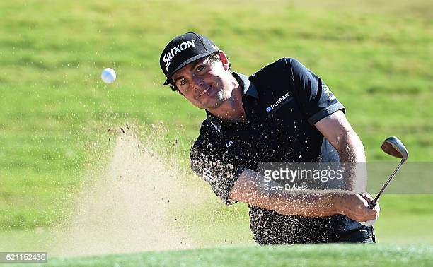 Keegan Bradley of the United States plays a shot from a bunker on the ninth hole during the second round of the Shriners Hospitals For Children Open...