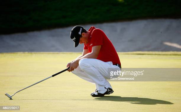 Keegan Bradley of the United States reacts after putting for birdie on the 18th green during the final round of the Arnold Palmer Invitational...
