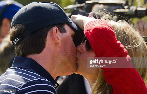 Keegan Bradley of the US gets a kiss from his girlfriend Jillian Stacey after The Morning Foursomes on the second day of play for The 39th Ryder Cup...