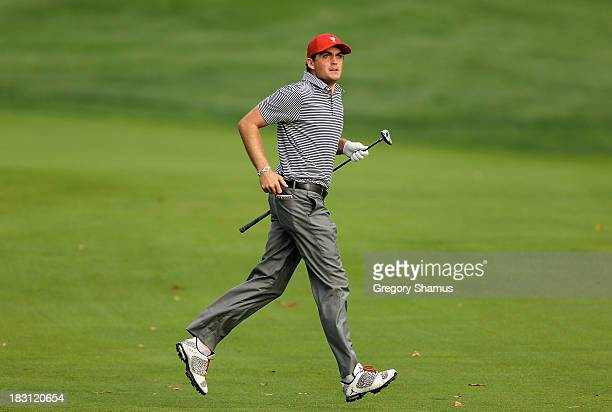 Keegan Bradley of the US Team watches a shot during the Day Two Foursome Matches at the Muirfield Village Golf Club on October 4 2013 in Dublin Ohio