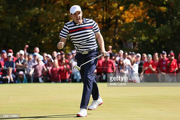 Keegan Bradley of the USA celebrates a putt during the Singles Matches for The 39th Ryder Cup at Medinah Country Club on September 30 2012 in Medinah...