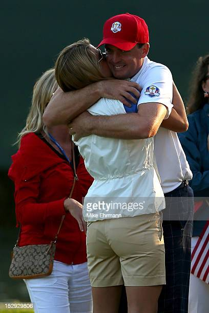 Keegan Bradley of the USA hugs his girlfriend Jillian Stacey on the 17th green after defeating the McIlroy/McDowell team 21 during the Afternoon...