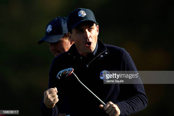 Keegan Bradley of the USA reacts after putting on the fifth green during day two of the Morning Foursome Matches for The 39th Ryder Cup at Medinah...