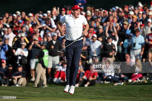 Keegan Bradley of the USA reacts to a missed putt on the 15th green during the Afternoon FourBall Matches for The 39th Ryder Cup at Medinah Country...