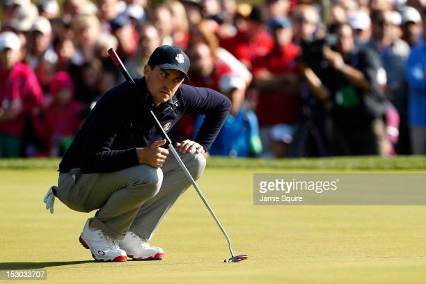 Keegan Bradley of the USA stares down a putt during day two of the Morning Foursome Matches for The 39th Ryder Cup at Medinah Country Club on...