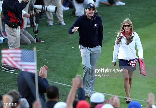 Keegan Bradley of the USA walks with his girlfriend Jillian Stacey during day two of the Afternoon FourBall Matches for The 39th Ryder Cup at Medinah...