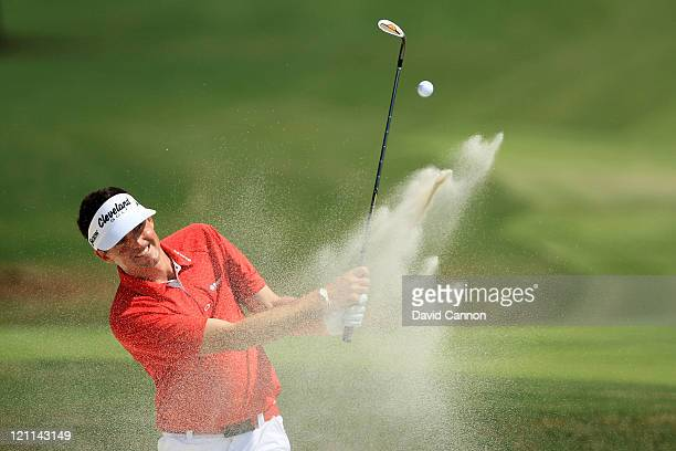 Keegan Bradley plays a bunker shot on the fifth hole during the final round of the 93rd PGA Championship at the Atlanta Athletic Club on August 14...