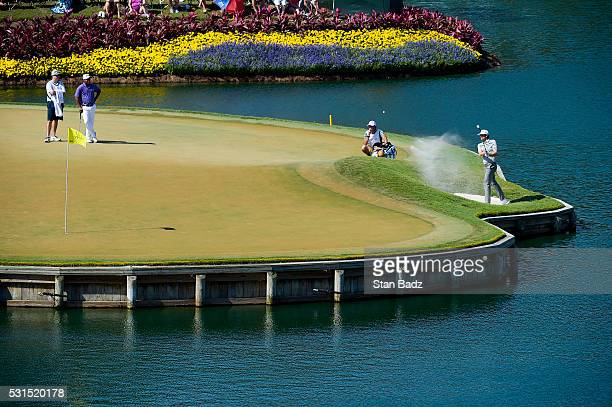 Keegan Bradley plays a shot from the bunker on the 17th hole during the third round of THE PLAYERS Championship on THE PLAYERS Stadium Course at TPC...