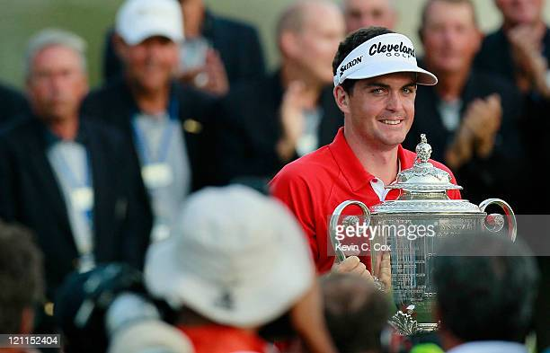 Keegan Bradley poses for photographers with the Wanamaker Trophy after winning a threehole playoff over Jason Dufner during the final round of the...