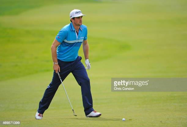 Keegan Bradley prepares to hit his third shot to the 17th green during the third round of the Northern Trust Open at Riviera Country Club on February...