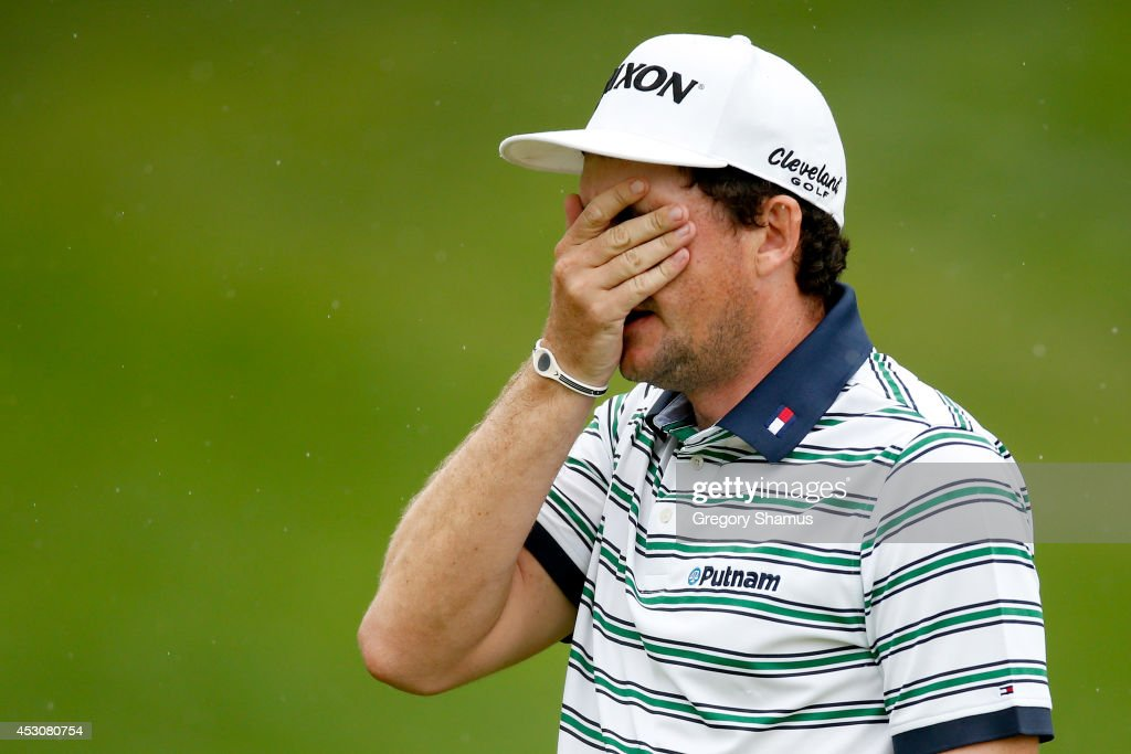 Keegan Bradley reacts to a putt on the 18th green during the third round of the World Golf Championships-Bridgestone Invitational at Firestone Country Club South Course on August 2, 2014 in Akron, Ohio.