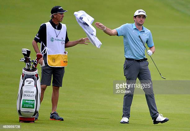 Keegan Bradley throws a towel to his caddie on the second hole during round two of the Northern Trust Open at Riviera Country Club on February 20...