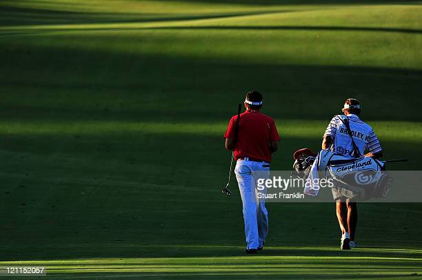 Keegan Bradley walks with his caddie Steve Hale during the playoff with Jason Dufner during the final round of the 93rd PGA Championship at the...