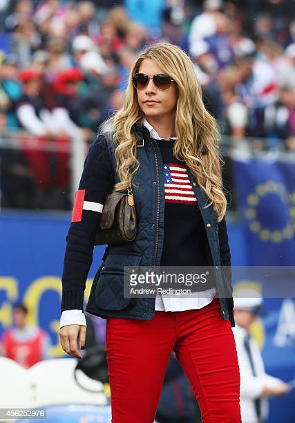 Keegan Bradley's partner Jillian Stacey walks the course during the Singles Matches of the 2014 Ryder Cup on the PGA Centenary course at the...