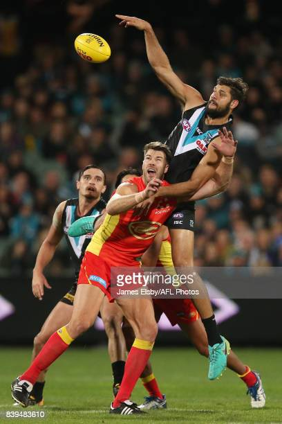 Keegan Brooksby of the Suns competes with Paddy Ryder of the Power during the 2017 AFL round 23 match between the Port Adelaide Power and the Gold...