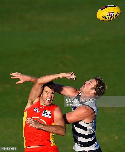 Keegan Brooksby of the Suns contests the ball with Dawson Simpson of the Cats during the NAB Challenge AFL match between the Gold Coast Suns and the...