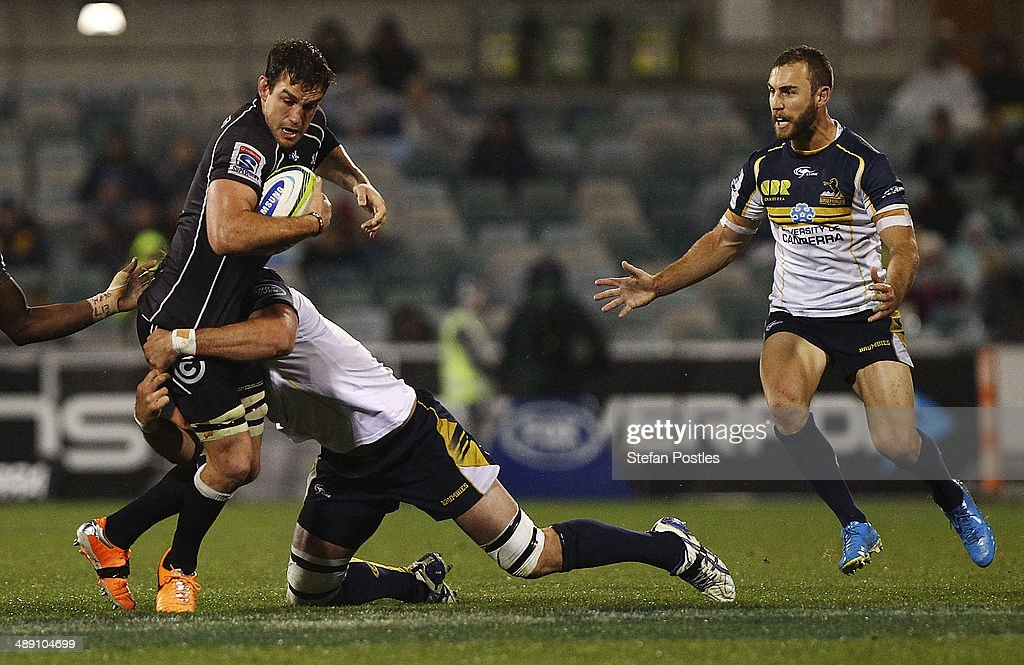 Keegan Daniel of the Sharks is tackled during the round 13 Super Rugby match between the Brumbies and the Sharks at Canberra Stadium on May 10, 2014 in Canberra, Australia.