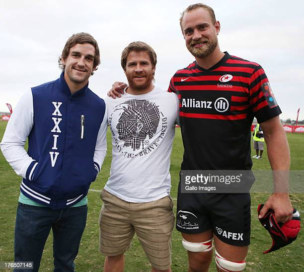 Keegan Daniel of the Sharks with Craig Burden of the Sharks and Alistair Hargreaves of Saracens during an Exhibition match between College Rovers and...