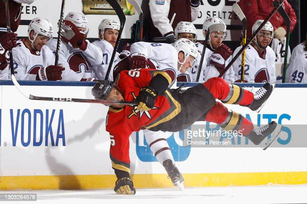 Keegan Kolesar of the Vegas Golden Knights and Cale Makar of the Colorado Avalanche collide during the third period during the NHL Outdoors at Lake...