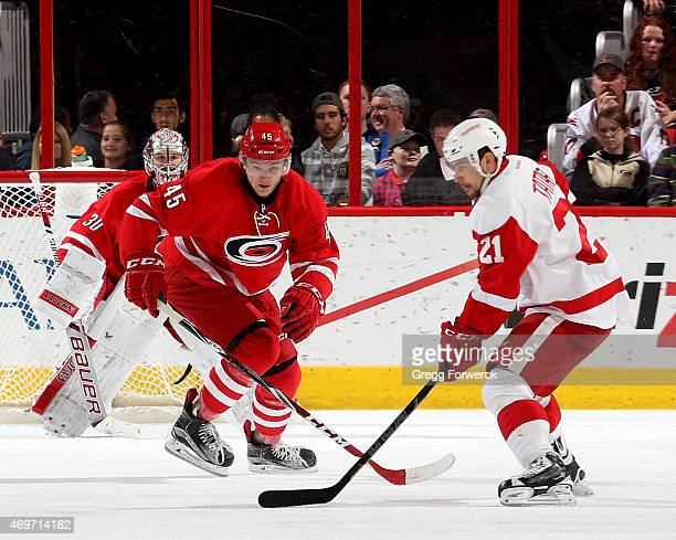 Keegan Lowe of the Carolina Hurricanes squares up to block a shot by Tomas Tatar of the Detroit Red Wings during their NHL game at PNC Arena on April...