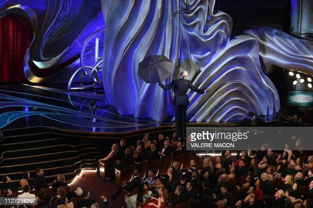 Keegan Michael Key comes down from the roof with an umbrella during the 91st Annual Academy Awards at the Dolby Theatre in Hollywood California on...