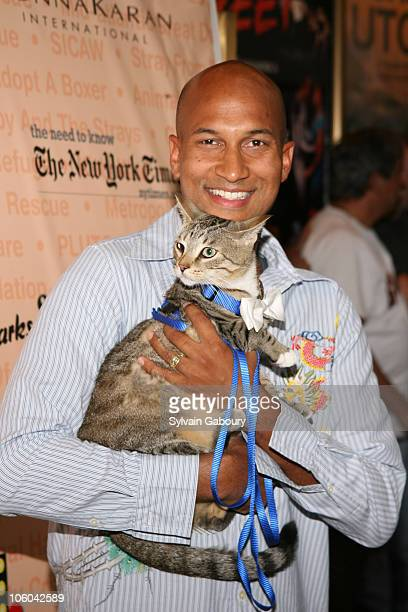 Keegan Michael Key with cat Fred during Broadway Barks 8 at Shubert Alley in New York NY United States