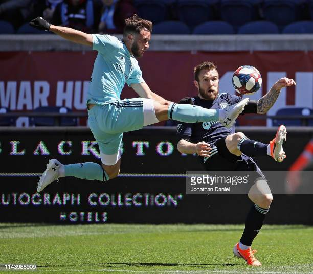 Keegan Rosenberry of Colorado Rapids kicks the ball away from Aleksandar Katai of Chicago Fire at SeatGeek Stadium on April 20 2019 in Bridgeview...