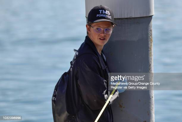 Keegan Thomas helps measure the distance from a pier pylon to the location of a dead body during a forensics class investigation in to a fictional...