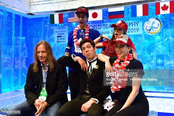 KeeganMessing of Canada waits for his score at the kiss and cry with his team matesv after competing in the Men's Single Free Skating on day two of...