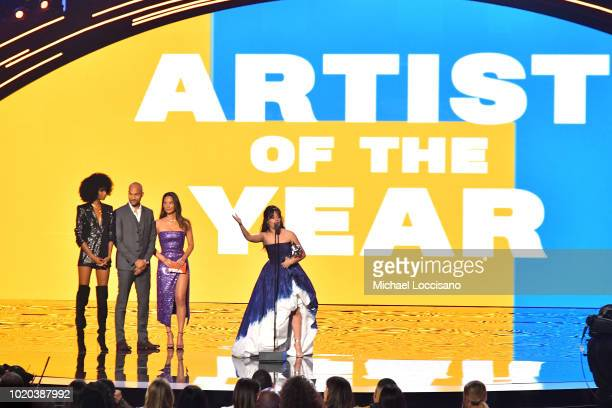 KeeganMichael Key and Olivia Munn present Camila Cabello with the Artist of the Year award onstage during the 2018 MTV Video Music Awards at Radio...