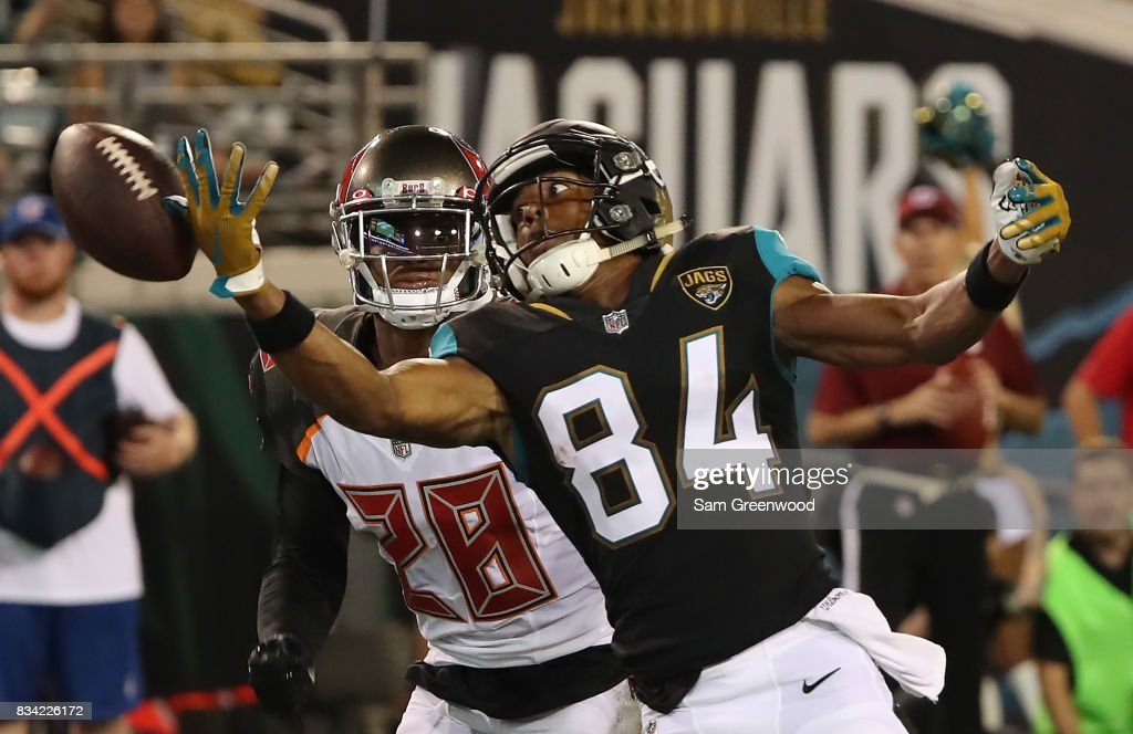 Keelan Cole #84 of the Jacksonville Jaguars attempts a reception against Vernon Hargreaves #28 of the Tampa Bay Buccaneers during a preseason game at EverBank Field on August 17, 2017 in Jacksonville, Florida.