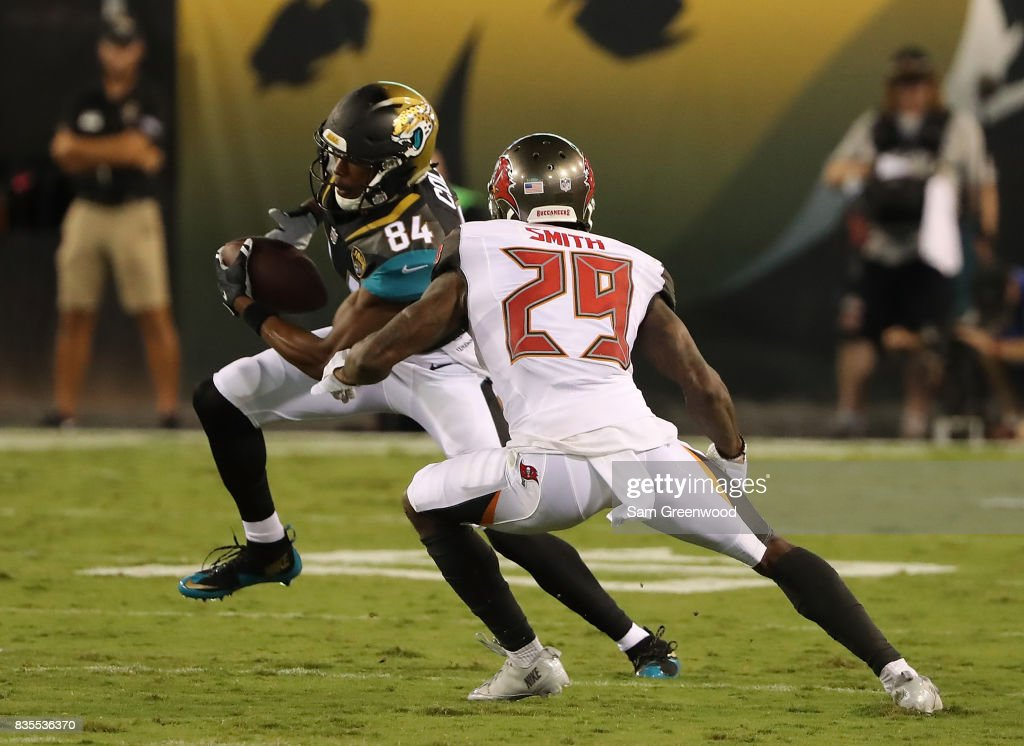 Keelan Cole #84 of the Jacksonville Jaguars attempts to run past Ryan Smith #29 of the Tampa Bay Buccaneers during a preseason game at EverBank Field on August 17, 2017 in Jacksonville, Florida.