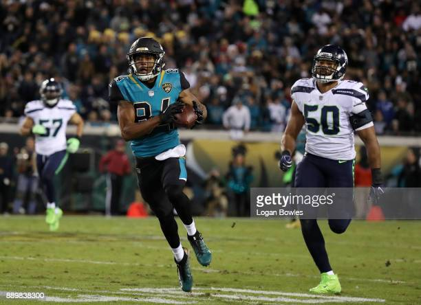 Keelan Cole of the Jacksonville Jaguars hauls in a 75yard touchdown in front of KJ Wright of the Seattle Seahawks during the second half of their...
