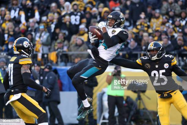 Keelan Cole of the Jacksonville Jaguars makes a catch defended by Artie Burns and Joe Haden of the Pittsburgh Steelers during the second half of the...