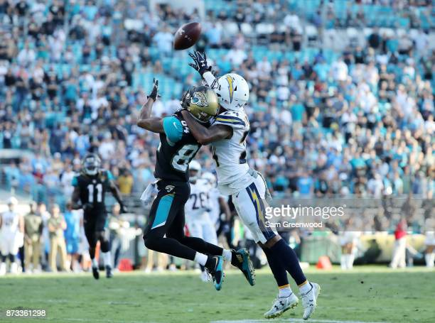 Keelan Cole of the Jacksonville Jaguars reaches for the football in front of Trevor Williams of the Los Angeles Chargers in the second half of their...