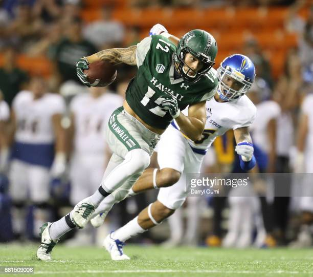 Keelan Ewaliko of the Hawaii Rainbow Warriors turns upfield after making a catch during the fourth quarter of the game against the San Jose State...