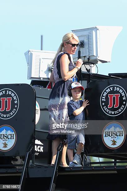 Keelan Harvick, the son of Kevin Harvick, driver of the Jimmy John's Chevrolet, stands on top of a hauler with his mother, DeLana, during qualifying...