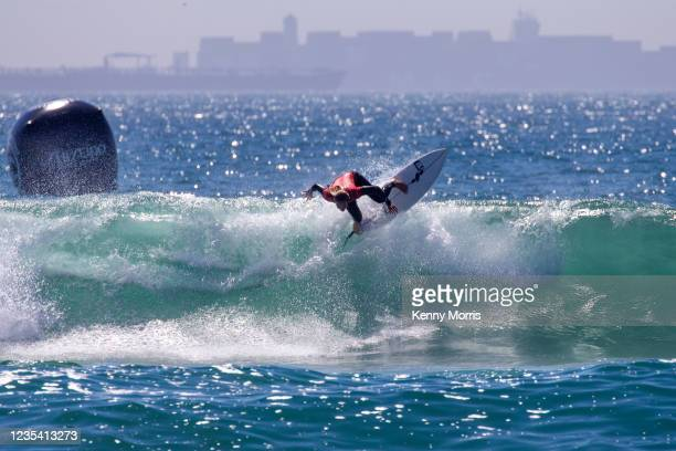 Keely Andrew of Australia surfs in Heat 1 of the Round of 64 at the US Open of Surfing Huntington Beach presented by Shiseido on September 21, 2021...