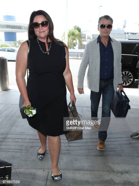 Keely Shaye Smith and Pierce Brosnan are seen at Los Angeles International Airport on June 14 2018 in Los Angeles California