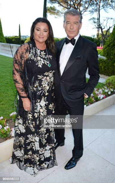 Keely Shaye Smith and Pierce Brosnan arrive at the amfAR Gala Cannes 2018 at Hotel du CapEdenRoc on May 17 2018 in Cap d'Antibes France