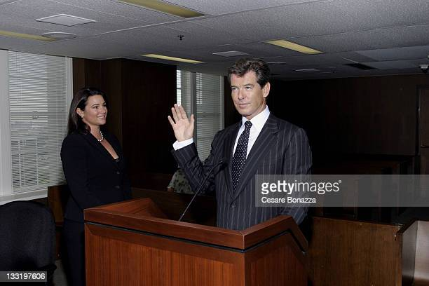 Keely ShayeSmith and Pierce Brosnan at the US District Court House where Pierce received his US Citizenship The act allows Pierce to cast his vote...