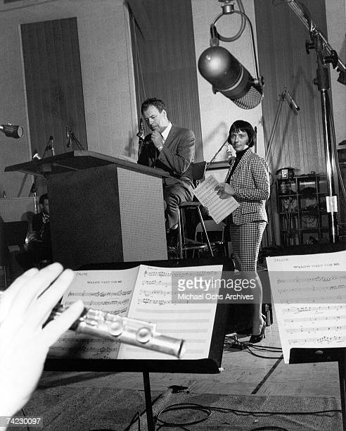 Keely Smith rehearses 'Willow Weep For Me' during a recording session with producer Nelson Riddle circa 1963 in Los Angeles California